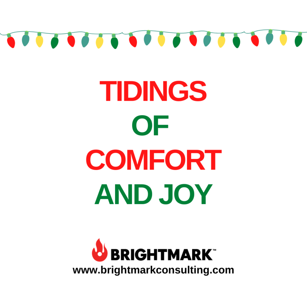 "BMK Graphic that says, ""Tidings of Comfort and Joy."" Christmas lights decorate the top."