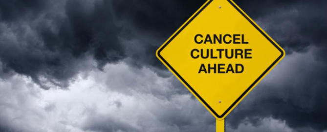 """Picture of a warning sign that says, """"Cancel Culture Ahead."""" The background is a dark, stormy sky."""