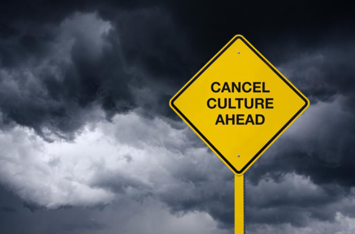 "Picture of a warning sign that says, ""Cancel Culture Ahead."" The background is a dark, stormy sky."